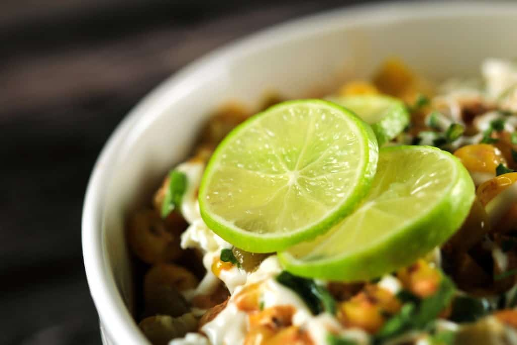 Creamy Mexican Corn Salad (Esquites) - This super easy and delicious salad is going to win your heart! Tastes completely authentic and will be ready in no time!! | ScrambledChefs.com
